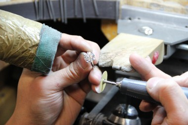 A $500,000 ring getting touched up by a Blue Nile expert.