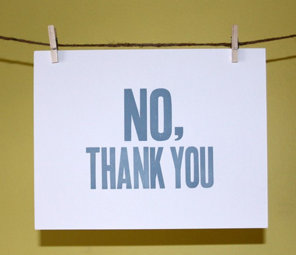 Saying no thank you sign