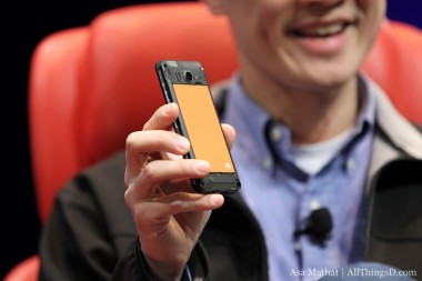 Xiaomi co-founder and president Bin Lin shows off one of the company's smartphones at D: Dive Into Mobile